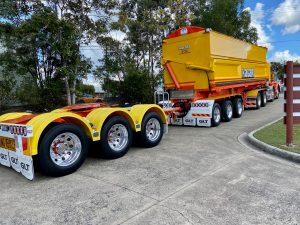 Kalari side tipper and tri axle dolly leaving the glt driveway